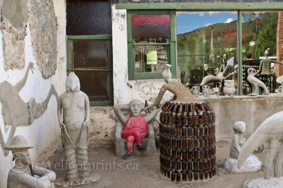 lady-with-beer-bottle-dress-cement-statues-owl-house-nieu-bethesda-south-africa