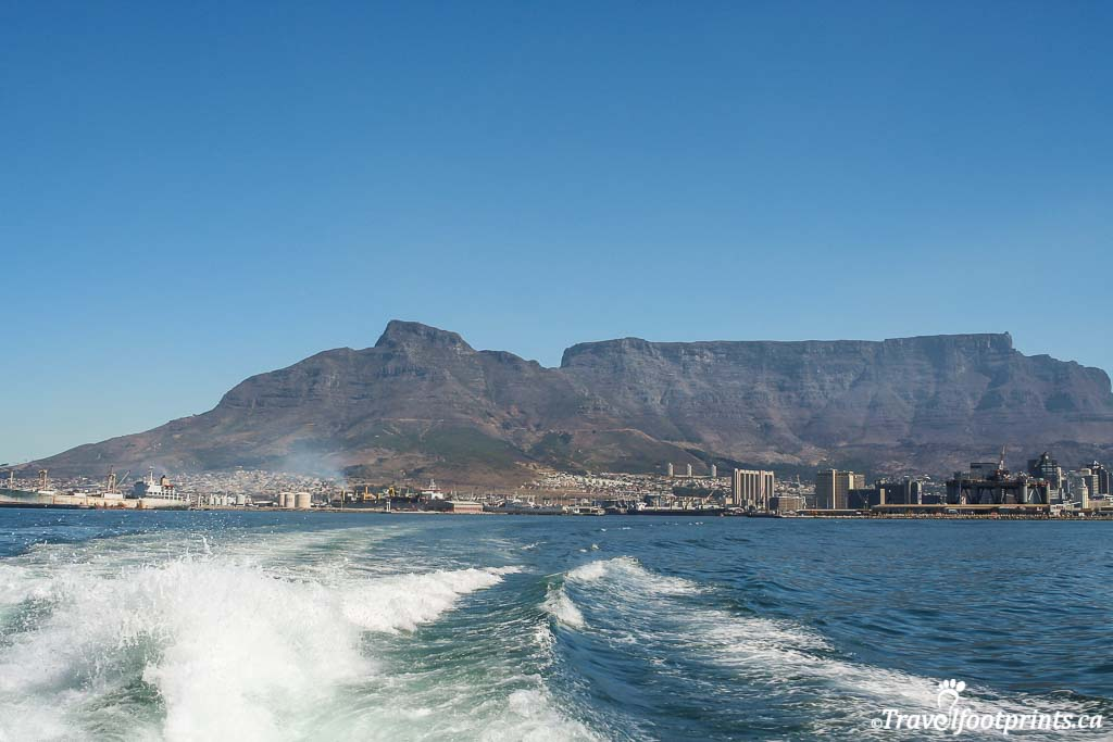 looking back at table mountain and cape town enroute to robben  island