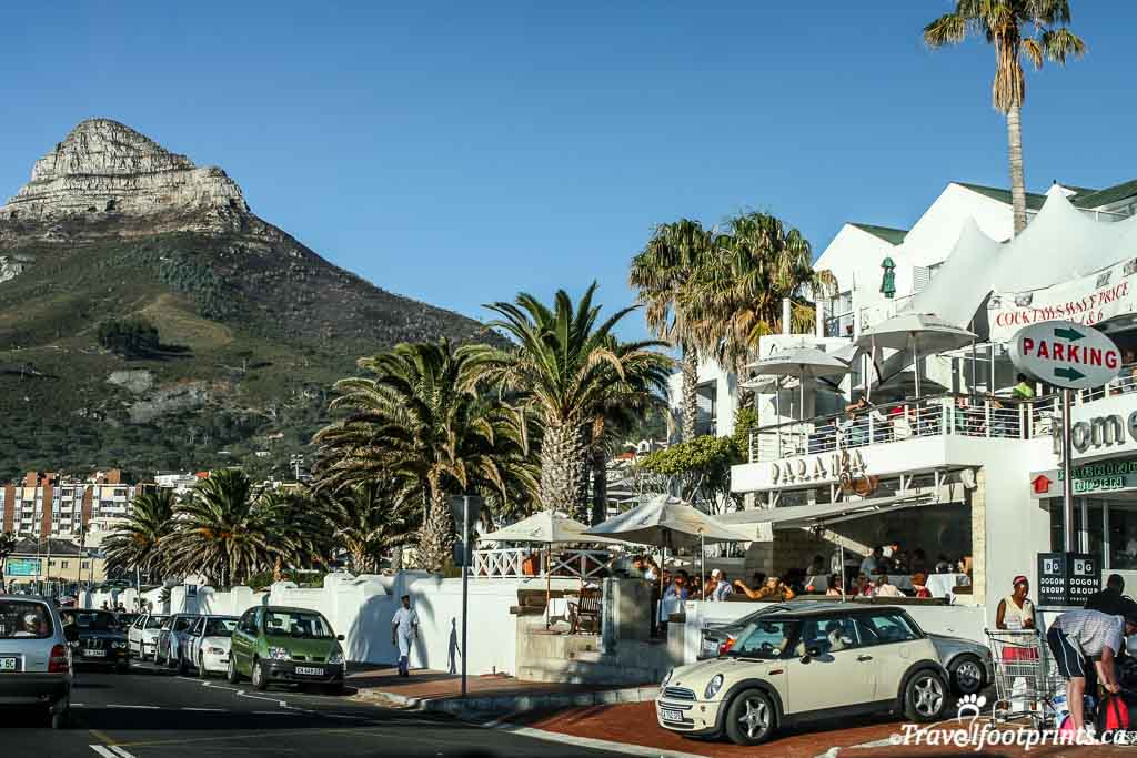 shops and restaurants at town of camps bay beach near cape town