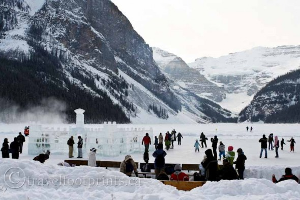 lake-louise-ice-magic-people-skating-glacier-mountains