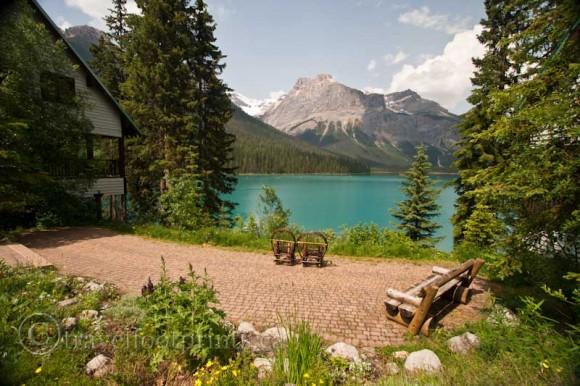 beautiful-emerald-lake-sitting-area-bench-view-blue-water