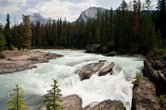 natural-bridge-kicking-horse-river-flowing-rocks