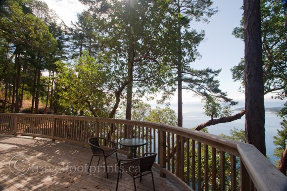 hornby-island-house-balcony-view-high-salal-arbutus-trees-ocean