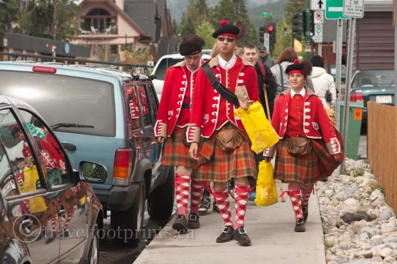 Canmore-highland-games-boys-kilts-walking-sidewalk