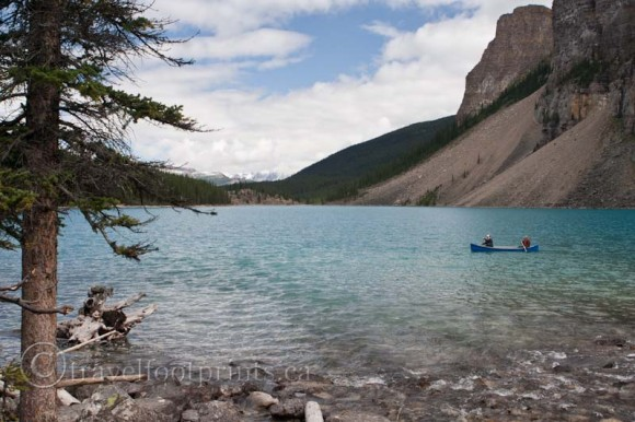moraine-lake-people-canoe-blue-water-ripples