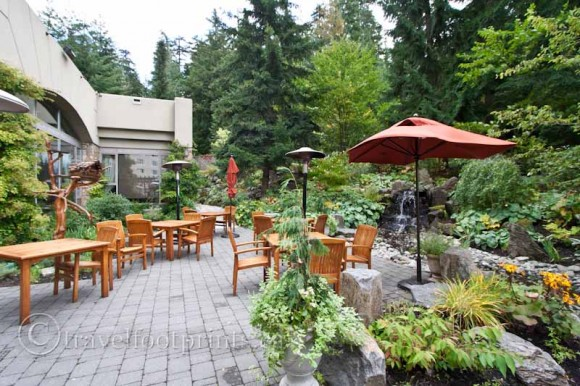 fairmont-chateau-whistler-hotel-outdoor-terrace-umbrella-tables-plants