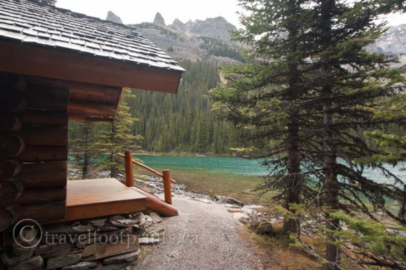 lake-ohara-lodge-cabin-blue-lake-water-trees