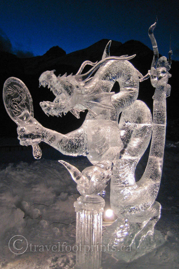 lake-louise-ice-magic-festival-night-vertical-dragon-sculpture-vertical-photo
