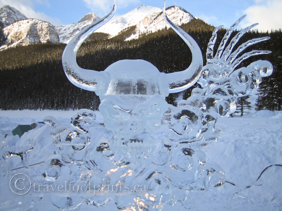 lake-louise-ice-magic-festival-skull-sculpture-mountains