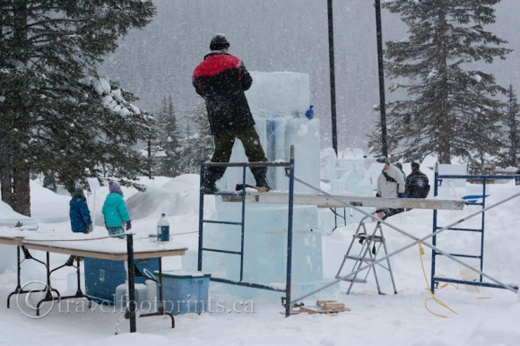 lake-louise-ice-magic-festival-carver-in-action-scaffolding-tables-ice scultpture