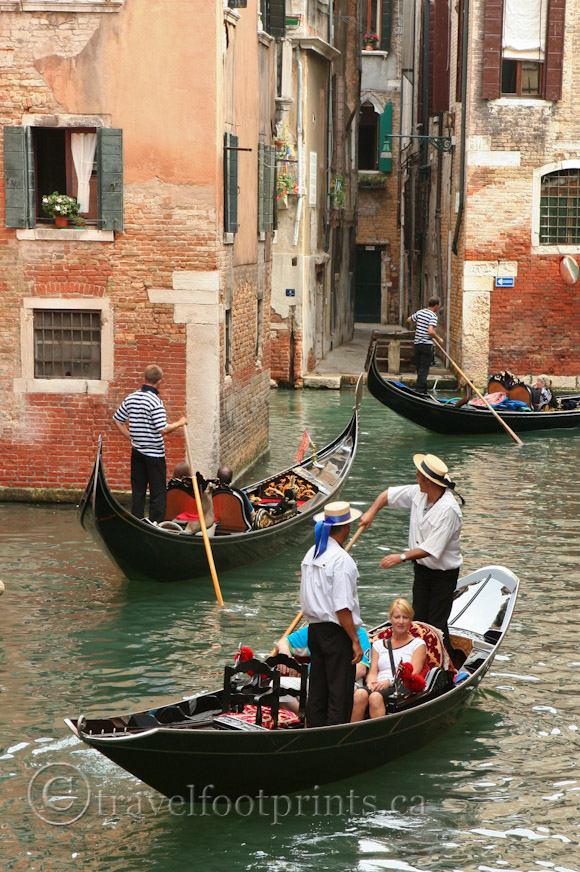 venice-three-gondolas-manuveur-through-canal-gondoliers-hats