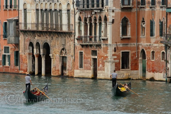 two-gondolas-gondoliers-tall-building-venice-italy