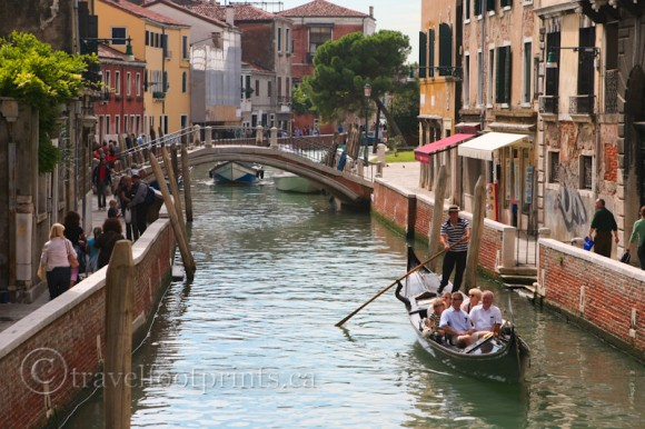 gondolier-venice-canal-tourists-walkway-italy-bridge