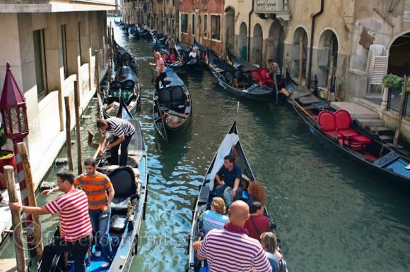 many-gondolas-busy-canal-venice-italy-gondoliers-stripe-shirt