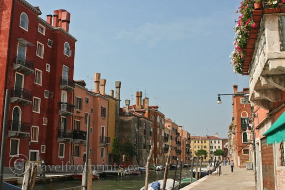 colorful-buildings-along-venice-canal-italy-sidewalk-boat