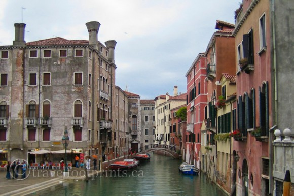 narrow-venice-canal-buildings-boats-italy