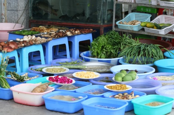 fresh-vegetables-in-plastic-tubs-outside