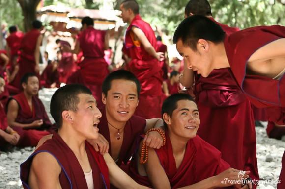 monks-smiling-sitting-sera-monastery-courtyard-debate-lhasa-tibet