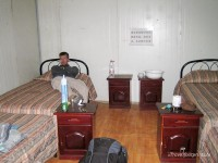 interior-metal-accommodation-nam-tso-lake-tibet-man-on-bed