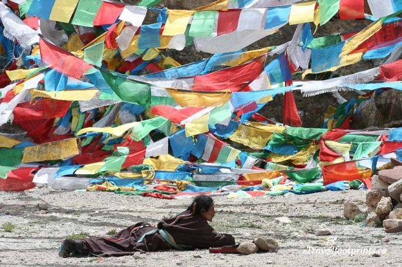 tibetan-prostrating-practice-religion-colorful-prayer-flags-tibet