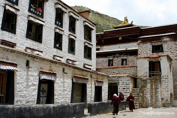 people-walking-outside-tibetan-building-lhasa