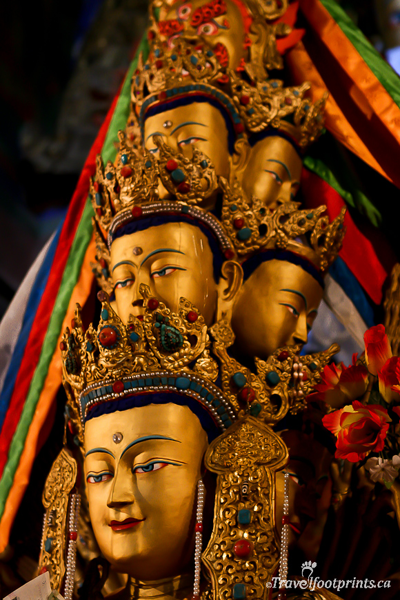 multiple-head-gold-statue-religion-tibet-colored-scarves
