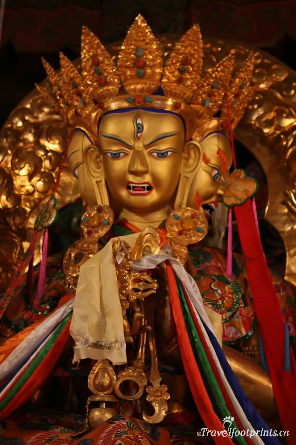 gold-three-headed-religious-statue-sera-monastery-colored-scarf-tibet