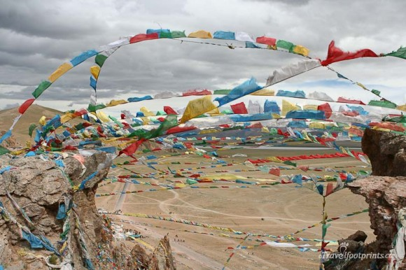 strings-0f-prayer-flags-blowing-in-wind-tibet-nam-tso-lake