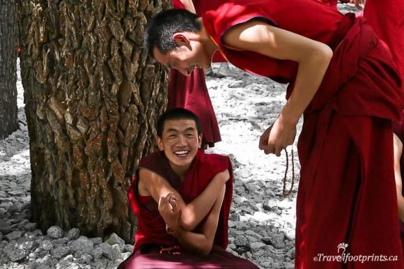 two-monks-laughing-sera-monastery-debates-lhasa-tibet