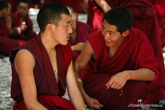 two-monks-sitting-red-robes-sera-monastery-lhasa-tibet
