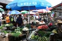 outdoor-vegetable-market-rural-china-umbrellas-vendors