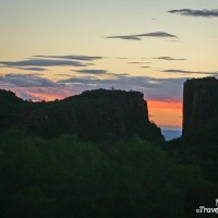 colourful sunset behind cliffs in valley of desolation