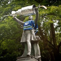 statue of lord stanley in the park with canucks jersey and stanley cup