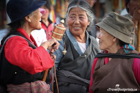 three-ladies-talking-laughing-hats-prayer-wheels-traditional-clothing-lhasa-tibet