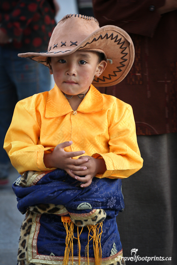 cute-young-boy-wearing-traditional-clothing-yellow-shirt-blue-pants-cowboy-hat-robe-lhasa