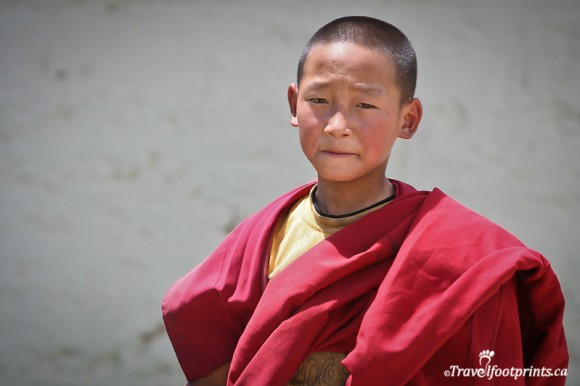 young-male-tibetan-monk-wearing-red-robe-lhasa