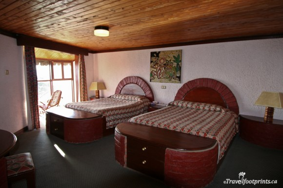 interior-ngorongoro-sopa-lodge-double-room-window-beds-safari-accommodation-tanzania-northern-circuit