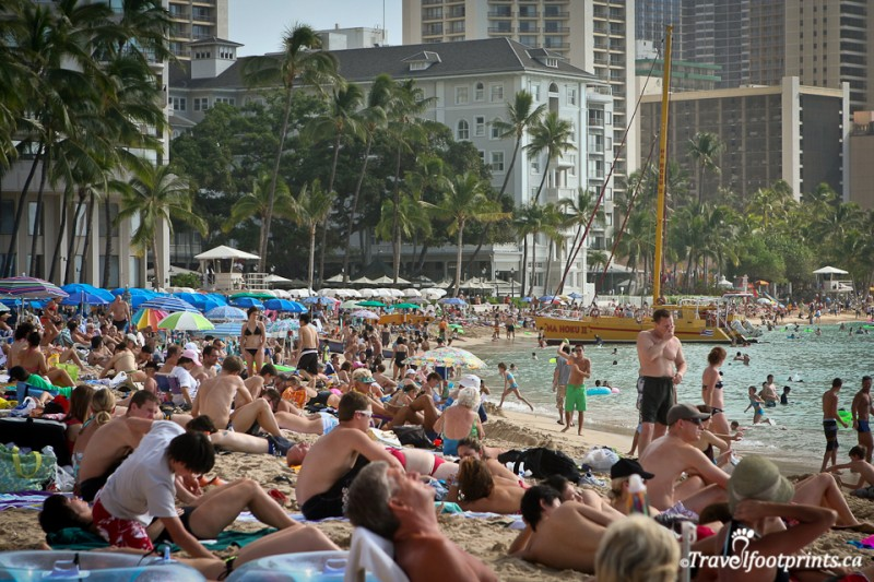 waikiki-beach-sand-crowded-people-umbrellas-hotels-boats-ocean-bathing-suits-tourists-oahu-hawaii-vacation-holiday
