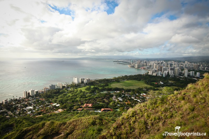 view-waikiki-panoramic-ocean-diamond-head-crater-summit-hike-scenic-walk-grass-skyscrapers-tropical-turquoise-water