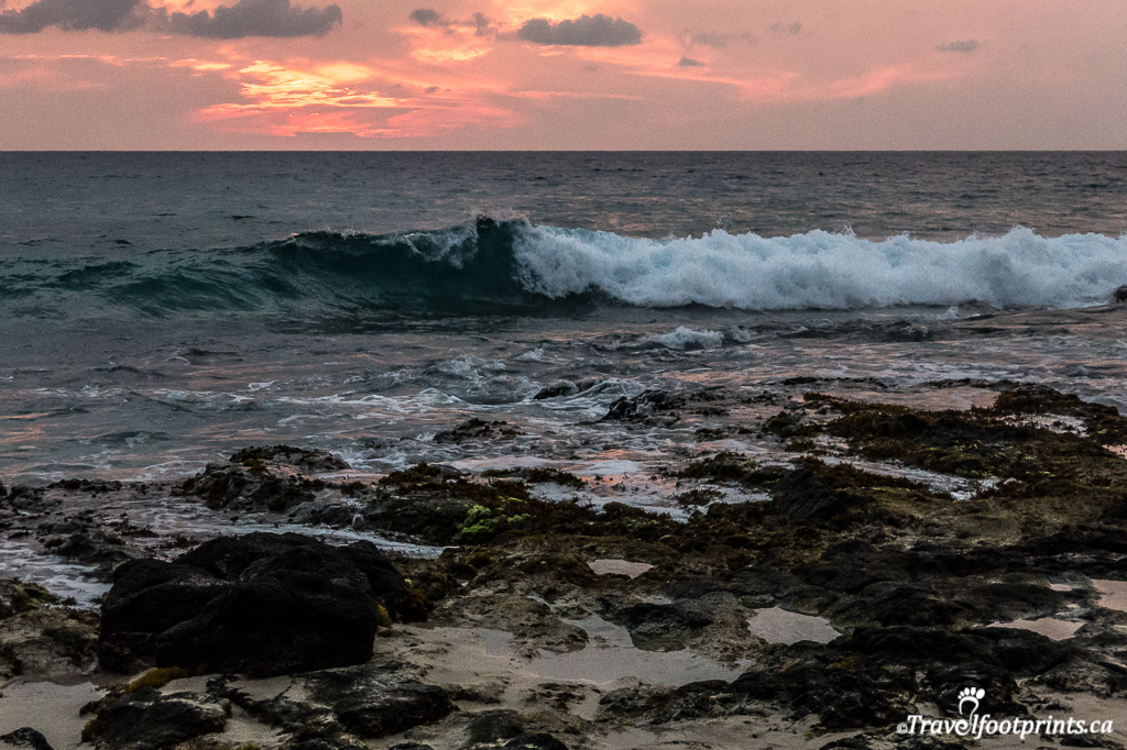 rough ocean waves with hawaii sunset