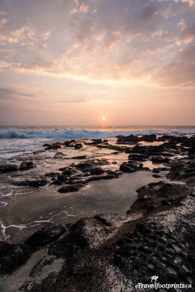 rugged ocean beach in pink hawaii sunset