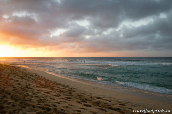 sand-beach-sunset-orange-glow-ocean-water-tropical-oahu-hawaii