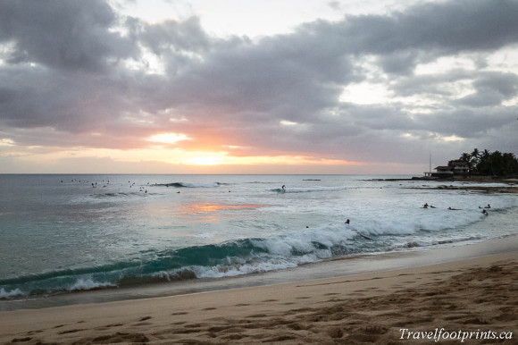 waves-on-beach-with-sunset-oahu-hawaii